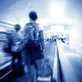 People at the airport escalator Royalty Free Stock Photos