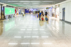 People at the Airport in the evening in Frankfurt, Germany Stock Photography