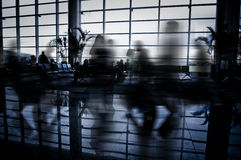 People at airport interior Stock Image