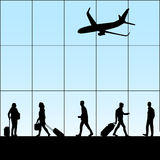 People in airport. Silhouette of people with luggage walking in airport Stock Images