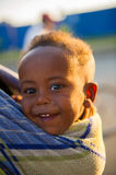 People in AKSUM,  ETHIOPIA. AKSUM, ETHIOPIA - SEP 30, 2011: Unidentified Ethiopian little cute happy boy is carried on his mother back in Ethiopia, Sep.30, 2011 Stock Photo