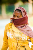 People in AKSUM, ETHIOPIA. AKSUM, ETHIOPIA - SEPTEMBER 24, 2011: Unidentified Ethiopian woman wears tissue and shuts her face. People in Ethiopia suffer of royalty free stock photo