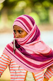 People in AKSUM, ETHIOPIA. AKSUM, ETHIOPIA - SEPTEMBER 24, 2011: Unidentified Ethiopian woman wears tissue and shuts her face. People in Ethiopia suffer of royalty free stock photography
