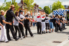 People of all ages line dancing in the street. Leek, Staffordshire, England, U.K - June, 21 2014 : People of all ages line dancing in the street as part of Leek stock images
