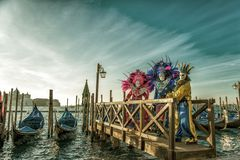 People in masks and costumes on Venetian carnival. People from all over the world come to the Venice Carnival Royalty Free Stock Image