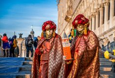 People in masks and costumes on Venetian carnival. People from all over the world come to the Venice Carnival Stock Images