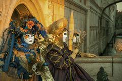 People in masks and costumes on Venetian carnival. People from all over the world come to the Venice Carnival Stock Photo