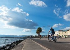 People along the Portixol promenade. PORTIXOL, MALLORCA, BALEARIC ISLANDS, SPAIN - SEPTEMBER 27, 2017: People out and about along the promenade on a sunny day on Royalty Free Stock Photography