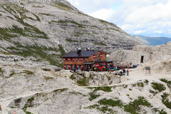 People at alpine Hut Bullelejochhutte in Sexten Dolomites, South Tyrol Royalty Free Stock Photos