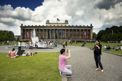 People in Altes museum. People enjoy the good weather and relax in front of Altes museum located on Museum Island in Berlin on June 12, 2012 royalty free stock images