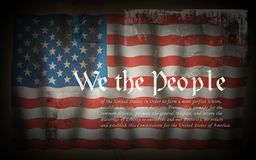 We The People American Constitution. Dramatic USA flag with white text. In grunge style royalty free illustration