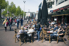 People in amsterdam enjoy sunny day on rembrandtplein. People in amsterdam enjoy sunny spring day on rembrandtplein stock image