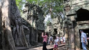 People at Angkor Thom temple complex in Siem Reap, Cambodia stock video