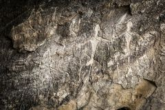 People and animals carved on rock, Gobustan royalty free stock photography