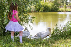 People and animals. Lovely charming kids playing having fun with Stock Image