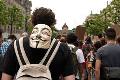People with anonymous mask during the demonstration against Monsanto and the transatlantique t Royalty Free Stock Image