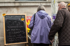 People at Anti UKIP stall in Thanet South. Couple looking at an Anti UKIP and Farage stall in Ramsgate, Thanet South during the General Election campaign in 2015 Royalty Free Stock Photos