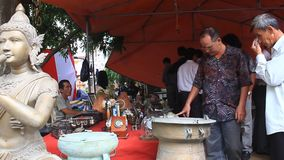 People in antiques market stock video footage