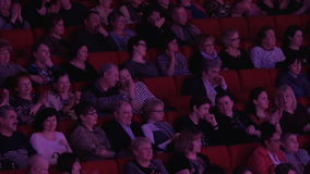 People applaud in the movie theater stock footage