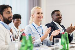 People applauding at business conference Stock Photo