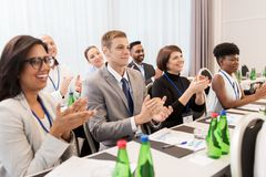 People applauding at business conference. Business and education concept - group of happy people applauding at international conference Stock Photo