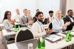People applauding at business conference. Business and education concept - group of happy people applauding at international conference Stock Images