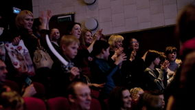 People applauding in the theatre
