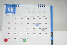 People appointment on August calendar for health and bill payment Stock Photo