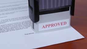 People approved conditions of the contract by stamp. Close up stock video footage