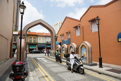 People in the Arab quarter in Singapore. SINGAPORE - CIRCA FEBRUARY, 2015: People in the Arab quarter (Kampong Glam). The Arab Quarter is the oldest historic Stock Photos