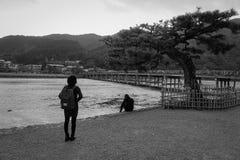 People at the Arashiyama park in Kyoto, Japan. People standing at the Arashiyama park in Kyoto, Japan Royalty Free Stock Photography