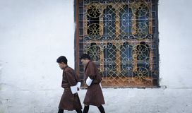 The people walking in traditional dress. The people and architecture of Paro, Bhutan in June, 2019 stock image