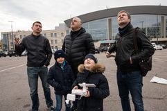 People in the area controlled drones. Saint-Petersburg, Russia - October 17, 2015: People in the town square drones learn to manage with the help of remote stock images