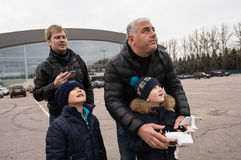 People in the area controlled drones. Saint-Petersburg, Russia - October 17, 2015: People in the town square drones learn to manage with the help of remote royalty free stock photography