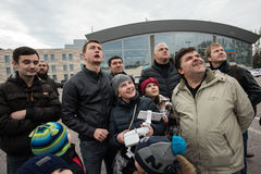 People in the area controlled drones. Saint-Petersburg, Russia - October 17, 2015: People in the town square drones learn to manage with the help of remote stock photos