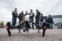 People in the area controlled drones. Saint-Petersburg, Russia - October 17, 2015: People in the town square drones learn to manage with the help of remote royalty free stock photos