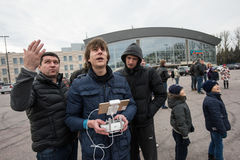 People in the area controlled drones. Saint-Petersburg, Russia - October 17, 2015: People in the town square drones learn to manage with the help of remote royalty free stock image