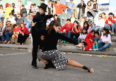 People of Argentina. BUENOS AIRES, LA BOCA, ARGENTINA - JUNE 05: Young tango dancers in traditional clothes performing on the street. La Boca street performers Royalty Free Stock Photo