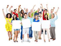 People Arms Outstretched And Holding 4 Empty Placards Royalty Free Stock Photography