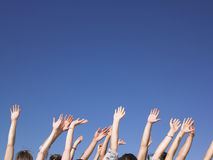 People With Arms Raised Stock Image