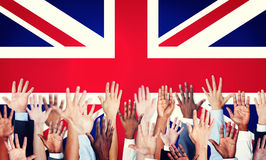 People Arms Raised and a Flag of United Kingdom Stock Photos