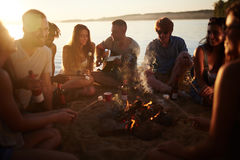 People around a campfire Stock Photography