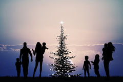 People around the Christmas tree Stock Images