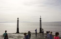 People around Columns Wharf in Lisbon Royalty Free Stock Images