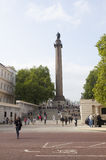 People around duke of york column seen from The Mall in London Stock Image