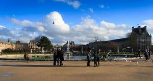 People around fountain in Paris Stock Photo