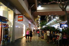 People around mall near Lego store and veronica secret. HONOLULU, HI - NOVEMBER 27: People around mall near Lego store and veronica secret on Grey Thursday at royalty free stock photography
