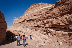 People around rock layers in valle de la luna. Shoot at valle de la luna, chile. here we can see different layers into te rock Royalty Free Stock Images