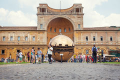 People around Sphere within sphere in Courtyard of the Pinecone. VATICAN: People around Sphere within sphere in Courtyard of the Pinecone at Vatican Museums Stock Images