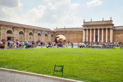 People around Sphere within sphere in Courtyard of the Pinecone. VATICAN: People around Sphere within sphere in Courtyard of the Pinecone at Vatican Museums Royalty Free Stock Photo